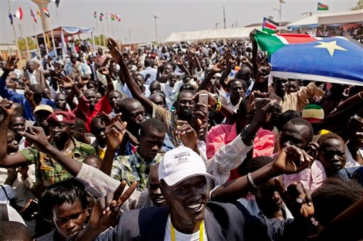 Southern Sudanese celebrate the announcement of preliminary referendum results in the southern capital of Juba on Sunday, Jan. 30, 2011.  (AP Photo/Pete Muller)