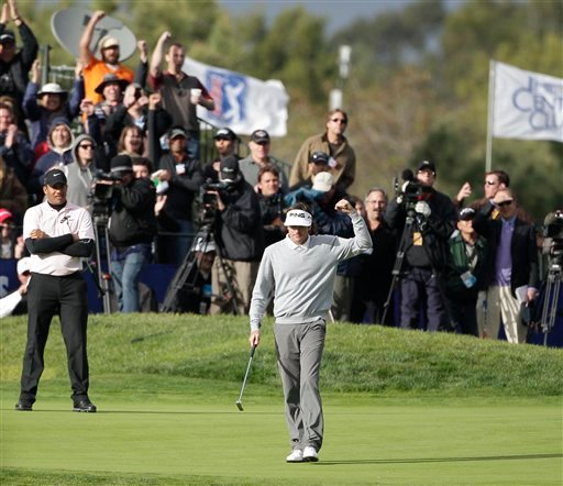 Bubba Watson pumps his fist after sinking a birdie putt on the 18th hole of the South Course at Torrey Pines that propelled him to victory in the Farmers Insurance Open golf tournament in San Diego, Sunday, Jan. 30, 2011. (AP)