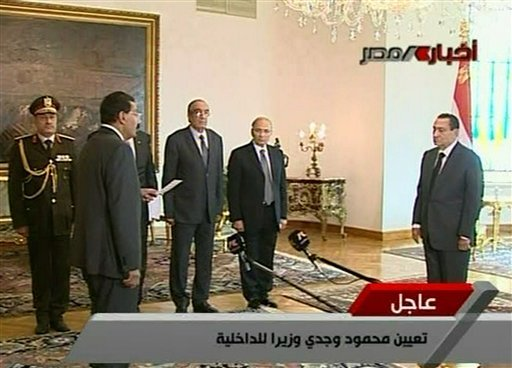 In this image taken from Egypt State TV, showing Egyptian President Hosni Mubarak, right, as he swears in Cabinet Minister for Communications and Information Technologies Dr. Tariq Mohamed Kmel Mamoud, front left. (AP)