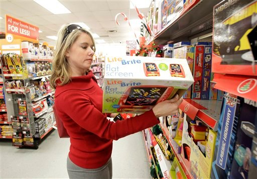 In this Dec. 14, 2010 photo, Carrie Marable of Waco, Texas, shops for a holiday gift at the Family Dollar store, in Waco, Texas. (AP Photo/Tony Gutierrez)