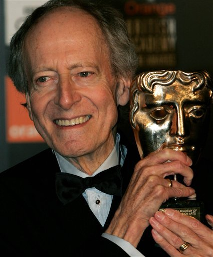 FILE - This is a Saturday, Feb. 12, 2005 file photo composer John Barry as he holds his Academy Fellowship award at the British Academy Film Awards in London's Leicester Square.
