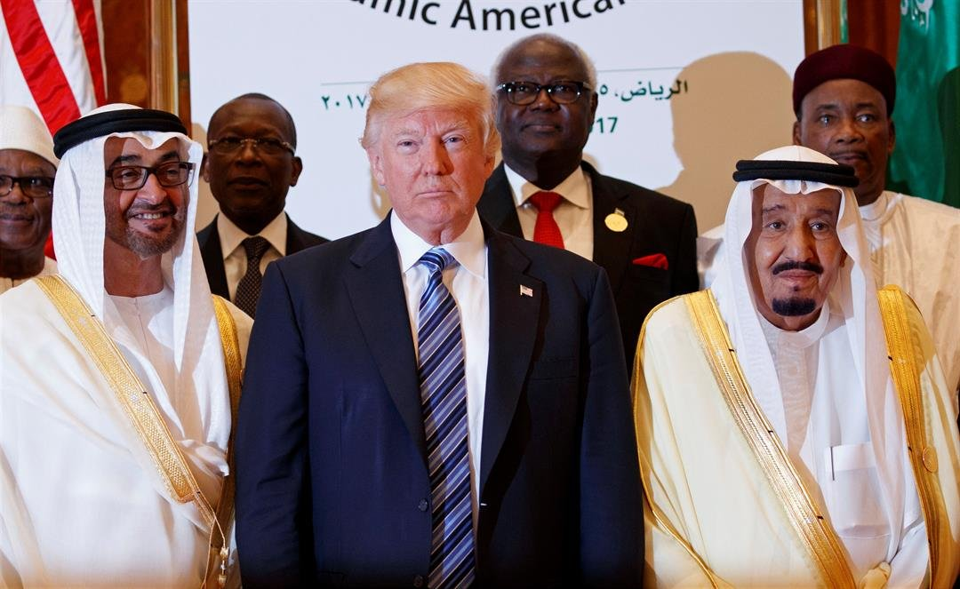 President Donald Trump poses for photos with King Salman and others at the Arab Islamic American Summit, at the King Abdulaziz Conference Center, Sunday, May 21, 2017, in Riyadh, Saudi Arabia. (AP Photo/Evan Vucci)