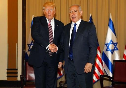 Israel's Prime Minister Benjamin Netanyahu, right and US President Donald Trump shake hands during a meeting in Jerusalem on Monday, May 22, 2017. ( Menahem Kahana, Pool via AP)