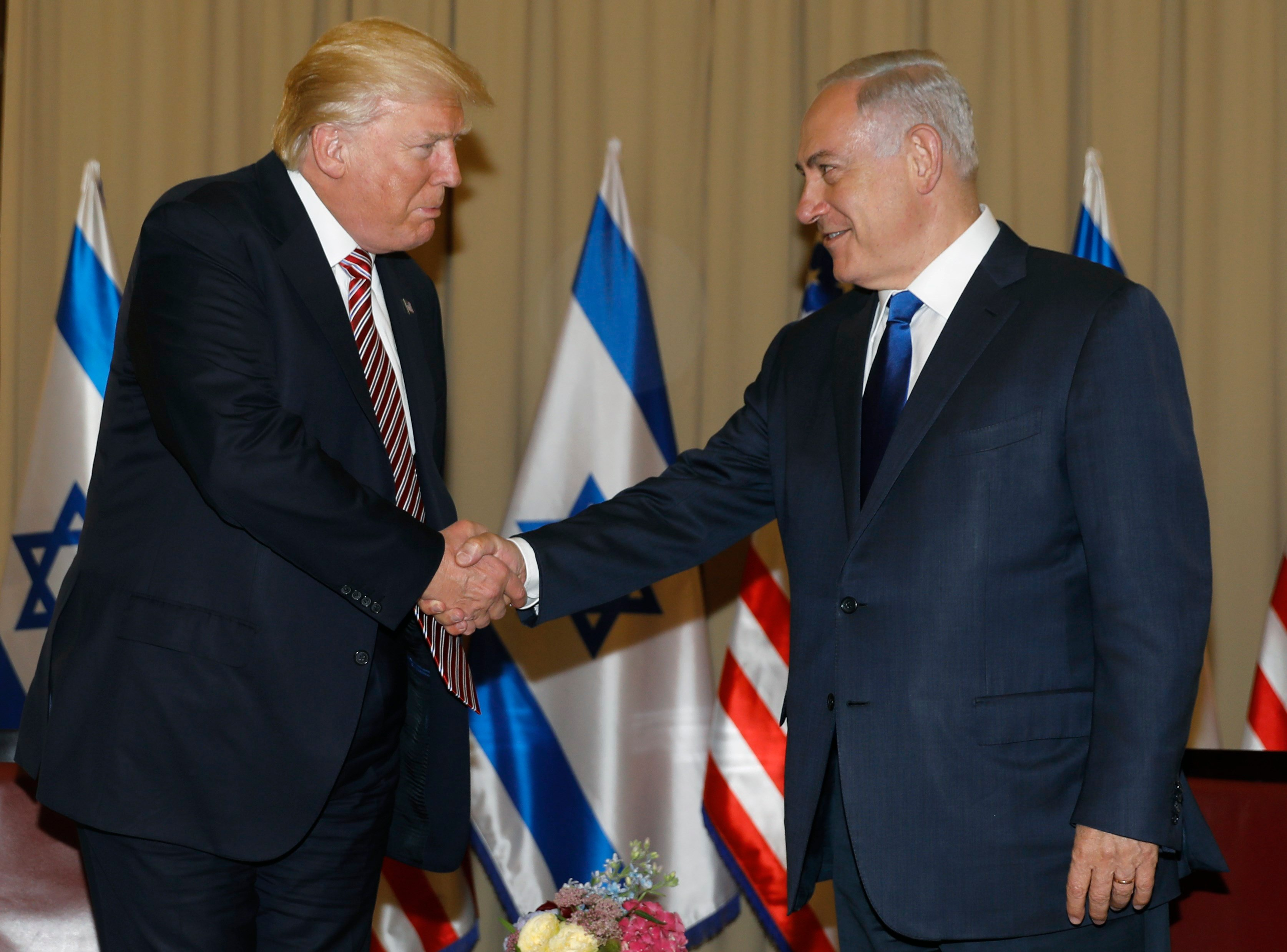 Israel's Prime Minister Benjamin Netanyahu, right and US President Donald Trump shake hands during a meeting in Jerusalem on Monday, May 22, 2017. (Menahem Kahana, Pool via AP)