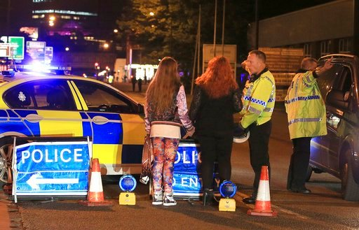 Police work at Manchester Arena after reports of an explosion at the venue during an Ariana Grande gig in Manchester, England Monday, May 22, 2017. (Peter Byrne/PA via AP)