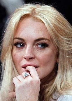 FILE - In this Jan. 9, 2011 file photo, Lindsay Lohan attends the Los Angeles Lakers New York Knicks NBA basketball game in Los Angeles.