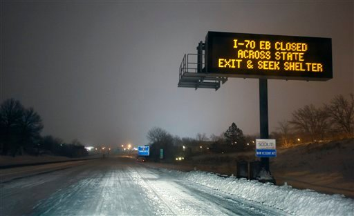 A Kansas City Scout sign warns motorists along I-70 near Kansas City, Mo., Tuesday, Feb. 1, 2011. I-70 was closed from Kansas City to St. Louis because of heavy snow. The area is under a blizzard warning until Wednesday. (AP Photo/Orlin Wagner)