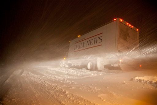 A newspaper delivery truck is stuck on Interstate 43 Wednesday, Feb. 2, 2011, in Grafton, Wi. The area is under a blizzard warning and some freeways were shut down. (AP Photo/Jeffrey Phelps)