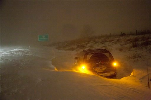 A vehicle is stranded on Interstate 43 Wednesday, Feb. 2, 2011, in Grafton, Wi. The area is under a blizzard warning and some freeways were shut down. (AP Photo/Jeffrey Phelps)