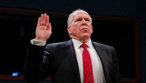 Former CIA Director John Brennan is sworn-in on Capitol Hill in Washington.
