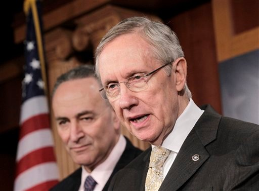 Senate Majority Leader Harry Reid of Nev., accompanied by Sen. Charles Schumer, D-N.Y., speaks during a news conference in Washington Feb. 2, 2011, to respond to Republican critics on health care and the aviation bill. (AP Photo/J. Scott Applewhite)