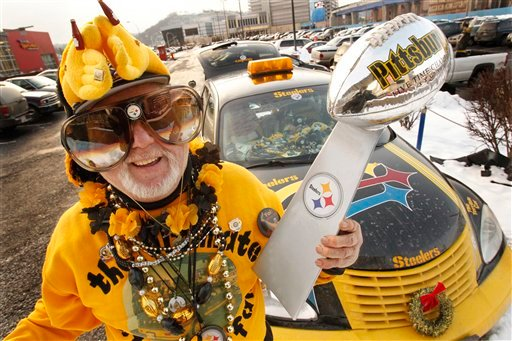 """In this photo taken Jan 28, 2011, the Pittsburgh Steelers """"Ultimate Fan"""" Bud Recktewald of Pittsburgh, cheers outside Heinz Field before a pep rally in Pittsbugh."""