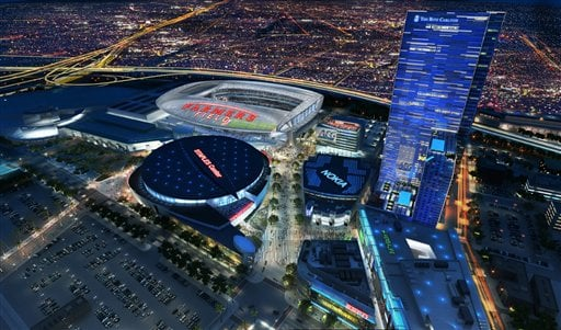 In an image provided by AEG, a proposed NFL football stadium, to be named Farmers Field, is depicted next to Staples Center in Los Angeles.