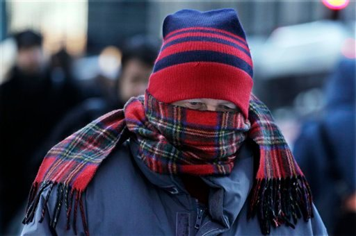 Commuters brave subzero wind chills as they return to work, Thursday, Feb. 3, 2011, in Chicago. This week's blizzard dumped more than 20 inches of snow on the city. (AP Photo/M. Spencer Green)