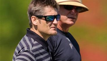 In this May 8, 2010, file photo, Atlanta Falcons general manager Thomas Dimitroff, left, talks with head coach Mike Smith during the morning session on the second day of NFL football mini-camp in Flowery Branch, Ga. (AP Photo/Paul Abell, File)