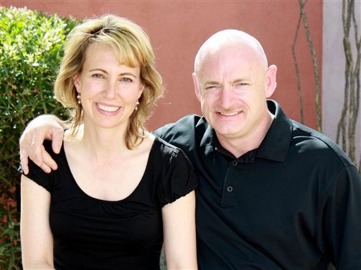 In this undated file photo provided by the office of Rep. Gabrielle Giffords, Giffords, left, is shown with her husband, NASA astronaut Mark Kelly. There are hints that astronaut Mark Kelly will take a shuttle into space in April.