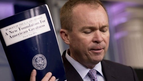 Budget Director Mick Mulvaney holds up a copy of President Donald Trump's proposed fiscal 2018 federal budget .