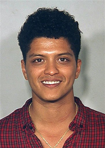 FILE - This Sept. 19, 2010 file image provided by the Las Vegas Metro Police Dept., shows singer Bruno Mars in a booking photo at the Clark County Detention Center in Las Vegas. Mars agreed Friday Jan. 28, 2011 to a plea deal that would get him a fine.
