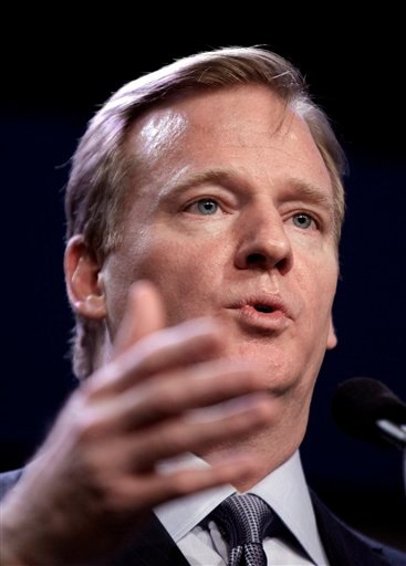 NFL Commissioner Roger Goodell answers a question during a news conference at the NFL football Super Bowl XLV Media Center in Dallas, Friday, Feb. 4, 2011.