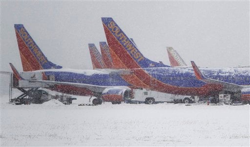 Southwest Airlines planes sit idle at Love Field airport as snow continues to fall, Friday, Feb. 4, 2011, in Dallas.