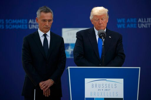 President Donald Trump and NATO Secretary General Jens Stoltenberg pause for a moment of silence to honor the victims of the terrorist attack in Manchester, Thursday, May 25, 2017. (AP Photo/Evan Vucci)