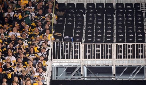 A section of empty seats are seen at Cowboys Stadium before the NFL football Super Bowl XLV game between the Green Bay Packers and the Pittsburgh Steelers Sunday, Feb. 6, 2011, in Arlington, Texas. The seats were deemed unsafe before the game. (AP Photo)