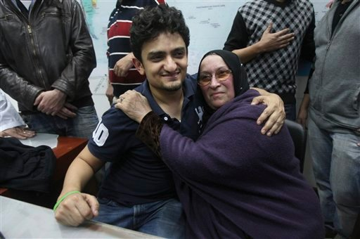 Egyptian Wael Ghonim, a Google Inc. marketing manager, who has become a hero of the demonstrators since he went missing on Jan. 27, two days after the protests began, hugs the mother of Khaled Said, a young 28-year-old businessman who died in June, 2010,