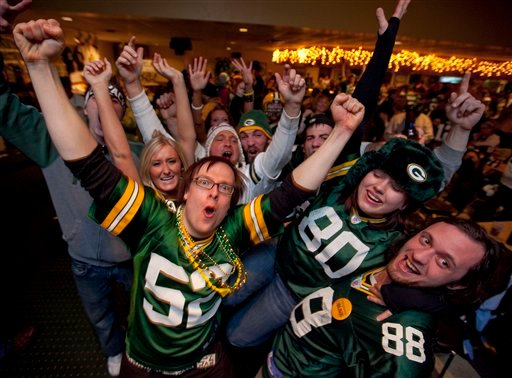 Green Bay Packers fans celebrate, Sunday, Feb. 6, 2011, at the Stadium View Bar near Lambeau Field in Green Bay, Wis., after the Packers won the Super Bowl XLV. The Packers defeated the Pittsburgh Steelers 31-25. (AP).
