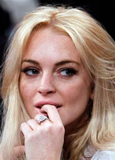 FILE - In this Jan. 9, 2011 file photo, Lindsay Lohan attends the Los Angeles Lakers New York Knicks NBA basketball game in Los Angeles. Prosecutors say they plan to charge Lohan on Wednesday Feb. 9, 2011.