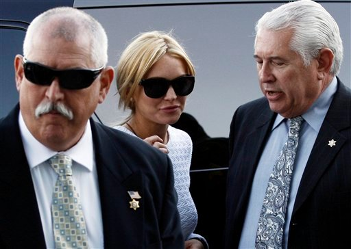 Actress Lindsay Lohan, center, arrives at the LAX Airport Courthouse in Los Angeles, Wednesday, Feb. 9, 2011, to be arraigned on a felony grand theft charge that prosecutors say they will file over a $2,500 necklace reported stolen.