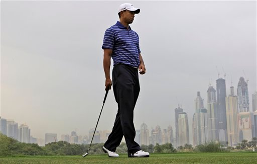 American Tiger Woods prepares to plays shot on the 8th hole during the Pro-Am at the Emirates Golf Club a day ahead of Dubai Desert Classic golf tournament in Dubai, United Arab Emirates, Wednesday Feb. 9, 2011.