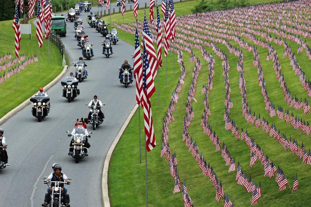 In this May 27, 2017 photo, motorcyclists ride into Indiantown Gap National Cemetery in Annville, Pa., for a Memorial Day weekend program. (AP Photo/Michael Rubinkam)