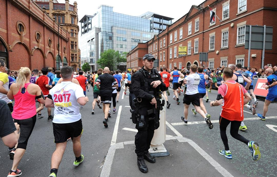 An armed police officer stands at the start of the Great Manchester Run in central Manchester, England, Sunday May 28, 2017. (AP Photo/Rui Vieira)