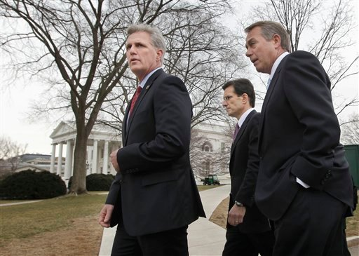 House Speaker John Boehner of Ohio, right, accompanied by House Majority Leader Eric Cantor of Va., center, and House Majority Whip Kevin McCarthy of Calif. leave the White House in Washington, Wednesday, Feb. 9, 2011.