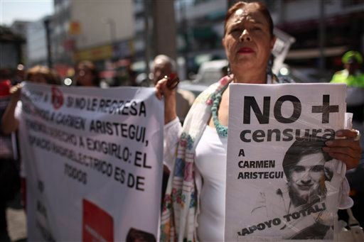 """A demonstrator holds a sign depicting Mexican journalist Carmen Aristegui that reads in Spanish """"No to censorship"""", outside the MVS radio station headquarters in Mexico City, Wednesday, Feb. 9, 2011."""