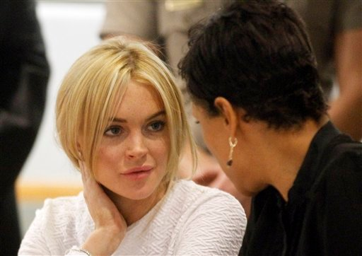 Actress Lindsay Lohan, left, appears in court during her arraignment on a felony grand theft charge with her lawyer Shawn Chapman Holley at the LAX Airport Courthouse in Los Angeles, Wednesday, Feb. 9, 2011. (AP Photo/Mario Anzuoni, Pool)