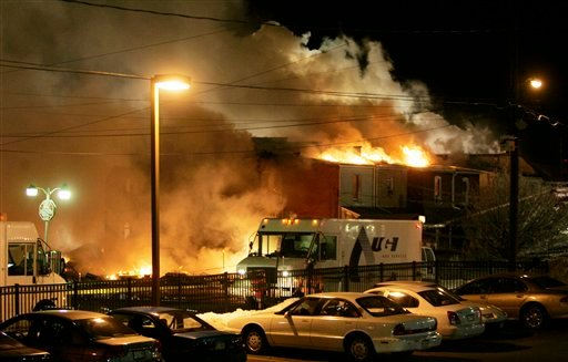 A fire rages out of control after an explosion near the intersection of 13th and Allen Streets in Allentown, Pa., early Thursday Feb. 10, 2011. (AP Photo/Rich Schultz)