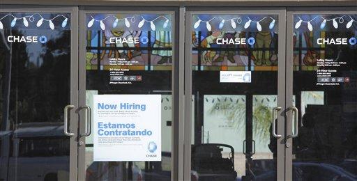 "In this Jan. 5, 2011 photo, a ""Now Hiring"" sign is shown at Chase bank in Santa Cruz, Calif. (AP Photo/Paul Sakuma)"