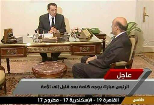 In this image taken from state TV aired Thursday Feb. 10, 2011 Egyptian President Hosni Mubarak speaks to his vice president, Omar Suleiman. (AP Photo/ Egypt TV via APTN)