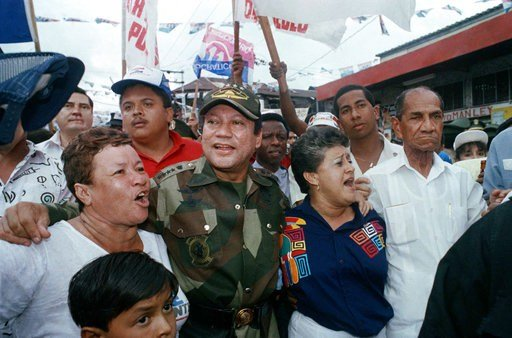 FILE - In this May 2, 1989 file photo, Gen. Manuel Antonio Noriega walks with supporters in the Chorrilo neighborhood, where he dedicated a new housing project, in Panama City.  (AP Photo/John Hopper, File)