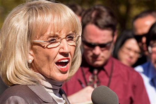Arizona Gov. Jan Brewer announces plans Thursday, Feb. 10, 2011 outside the Sandra Day O'Connor Federal Courthouse in Phoenix to countersue the federal government for failing to enforce immigration laws.