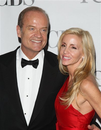 FILE - In this June 13, 2010 file photo, Kelsey Grammer and his wife Camille Grammer arrive at the 61st Annual Tony Awards in New York. A judge has granted Kelsey Grammer a divorce from his wife, clearing the way for the actor to remarry later this month.