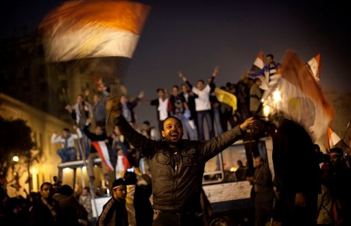 Anti-government protesters celebrate in Tahrir Square in downtown Cairo, Egypt , Egypt Friday, Feb. 11, 2011.