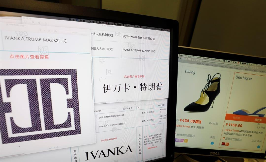 Trademark applications from Ivanka Trump Marks LLC images taken off the website of China's trademark database are displayed next to a Chinese online shopping website selling purported Ivanka Trump branded footwear on computer screens in Beijing, China, Fr