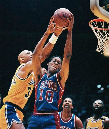In this June 11, 1989 file phot, Detroit Pistons' Dennis Rodman (10) grabs a rebound away from Los Angeles Lakers' Kareem Abdul-Jabbar, left, during Game 3 of the NBA Finals in Los Angeles.