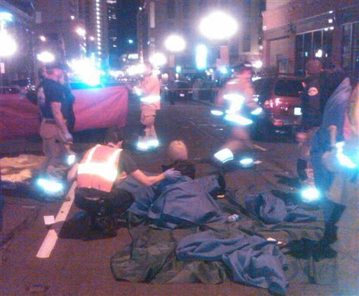 This image provided by the San Diego Fire and Rescue Department shows San Diego Fire Department paramedics assisting a victim at the site of a crash where a taxi cab driver plowed slowly into a crowd on a sidewalk.