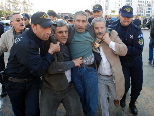Algerian riot Police push away protesters, during a demonstration in Algiers, Algeria, Saturday Feb. 12, 2011. (AP)