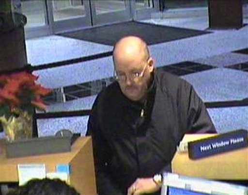 "This Dec. 19, 2008 file image taken from surveillance video provided by the U.S. Attorney's Office for the Eastern District of Virginia, shows a bank robbery suspect dubbed the ""Granddad Bandit"" robbing a Virginia bank. (AP Photo/U.S. Attorney's Office)"