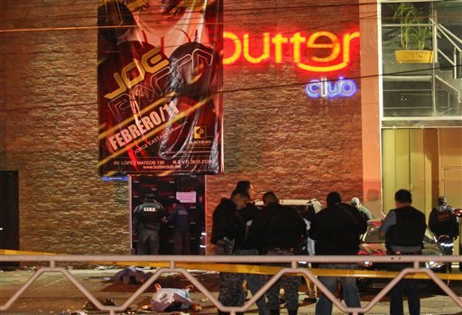 State police stand outside of a nightclub after gunmen opened fire and hurled a grenade in the western city of Guadalajara, Mexico, early Saturday, Feb. 12, 2011. Six people were killed and at least 37 were injured. (AP Photo)