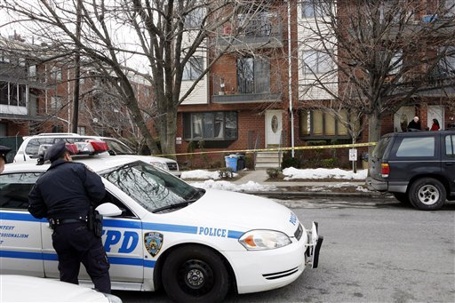 Police stand outside the house in the Brooklyn borough of New York where Maksim Gelman lived and where police say he killed his stepfather on Friday morning, Saturday, Feb. 12, 2011. (AP)